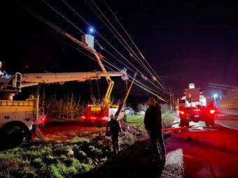 linemen working on power line at night